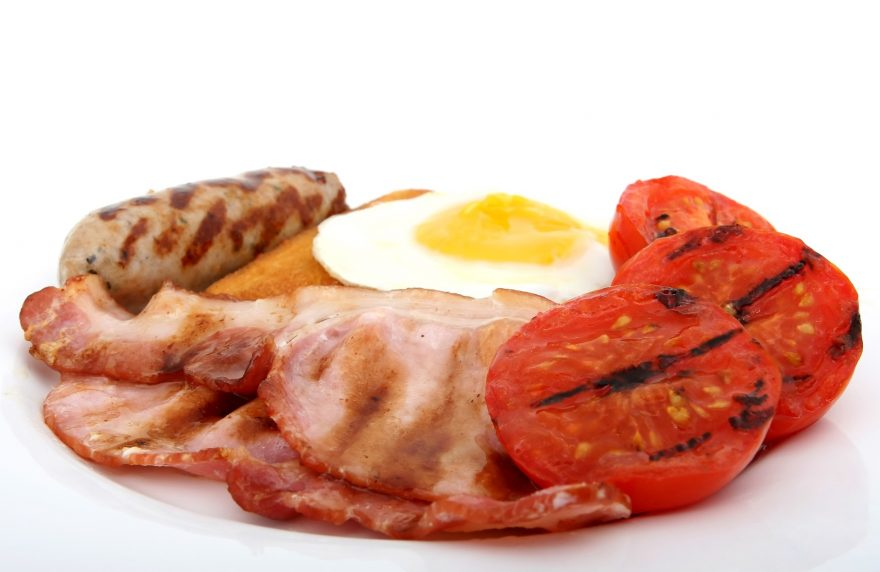 Fresh food, full fried english breakfast, macro closeup, close up over white with copy space.